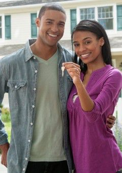 Couple with keys to the house