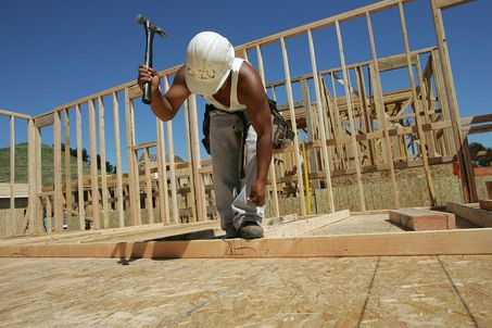 RICHMOND, CA - MARCH 31:  A construction worker hammers nails as he builds wall frames for a new home March 31, 2005 in Richmond, California. Sales of new U.S. homes soared 9.4 percent in February, the largest jump in more than four years and well above Wall Street forecasts.  (Photo by Justin Sullivan/Getty Images)